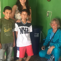 A family receives an in-home water filter