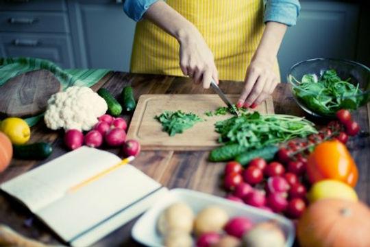Woman chopping vegetables.jpg