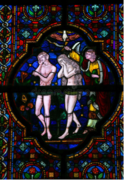 Old stain glass picture of Adam and Eve being banished from the Garden of Eden