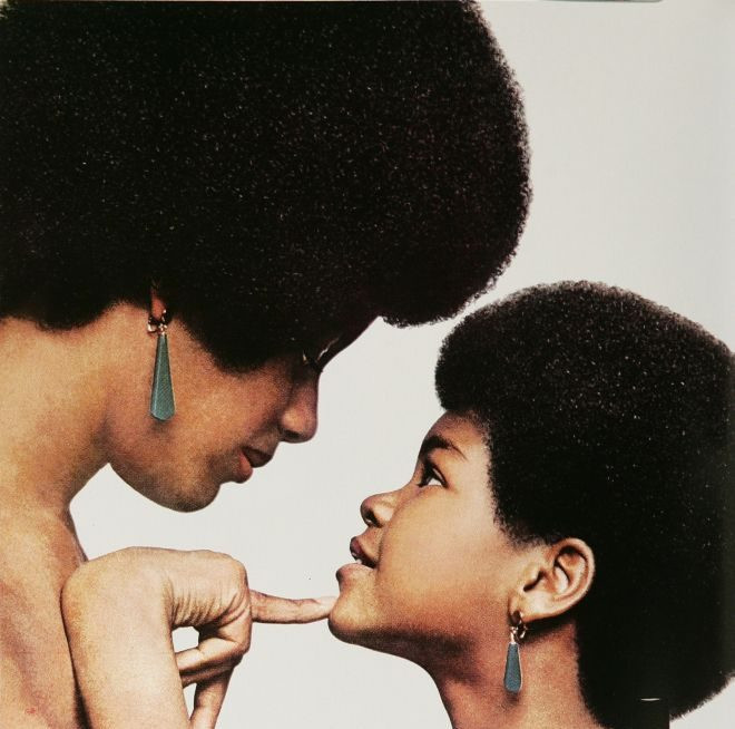 Mother and daughter, wearing large afros, in 1970's Afro Sheen hair grease ad