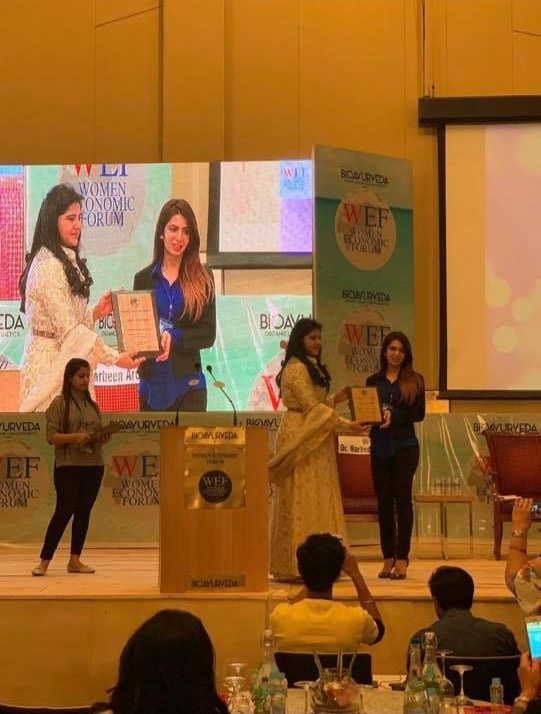 Receiving the Young Woman of Excellence Award from NGO Women Economic Forum 2019