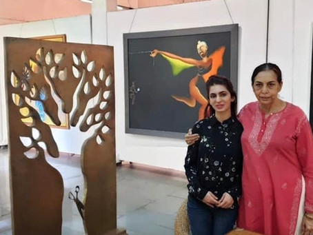ARPANA CAUR narrates anecdotes to Aashna behind her evoking artworks