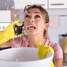 Shocked Woman Calling Plumber While Coll