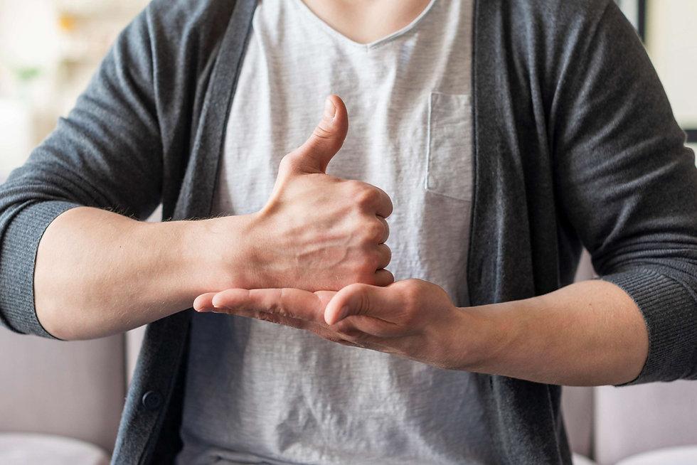 front-view-man-using-sign-language.jpg