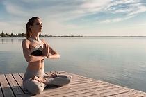 young-sports-lady-beach-make-meditation-exercises.jpg