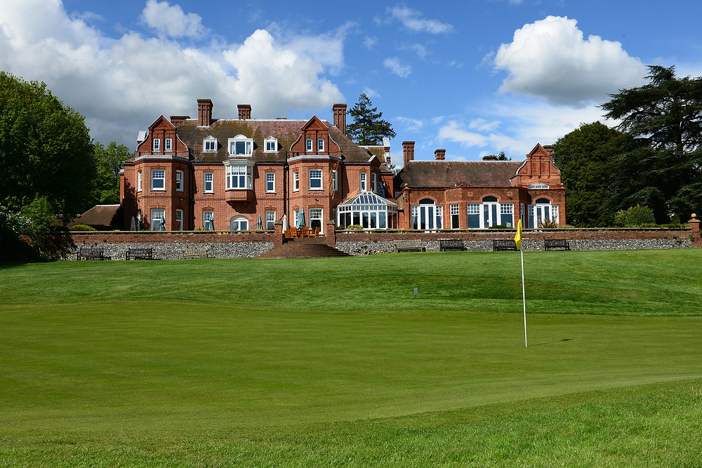 18th green view of Tyrrells Wood Golf Club House.jpg