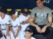 boy squeezing Yelich muscle.jpg