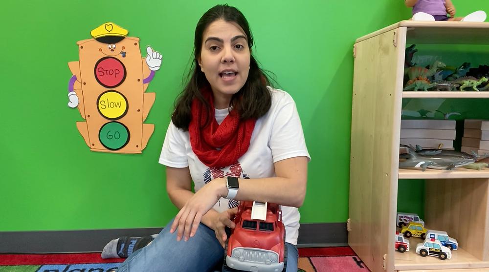 A Casa de Corazon staff member leads her class through a sign language lesson.