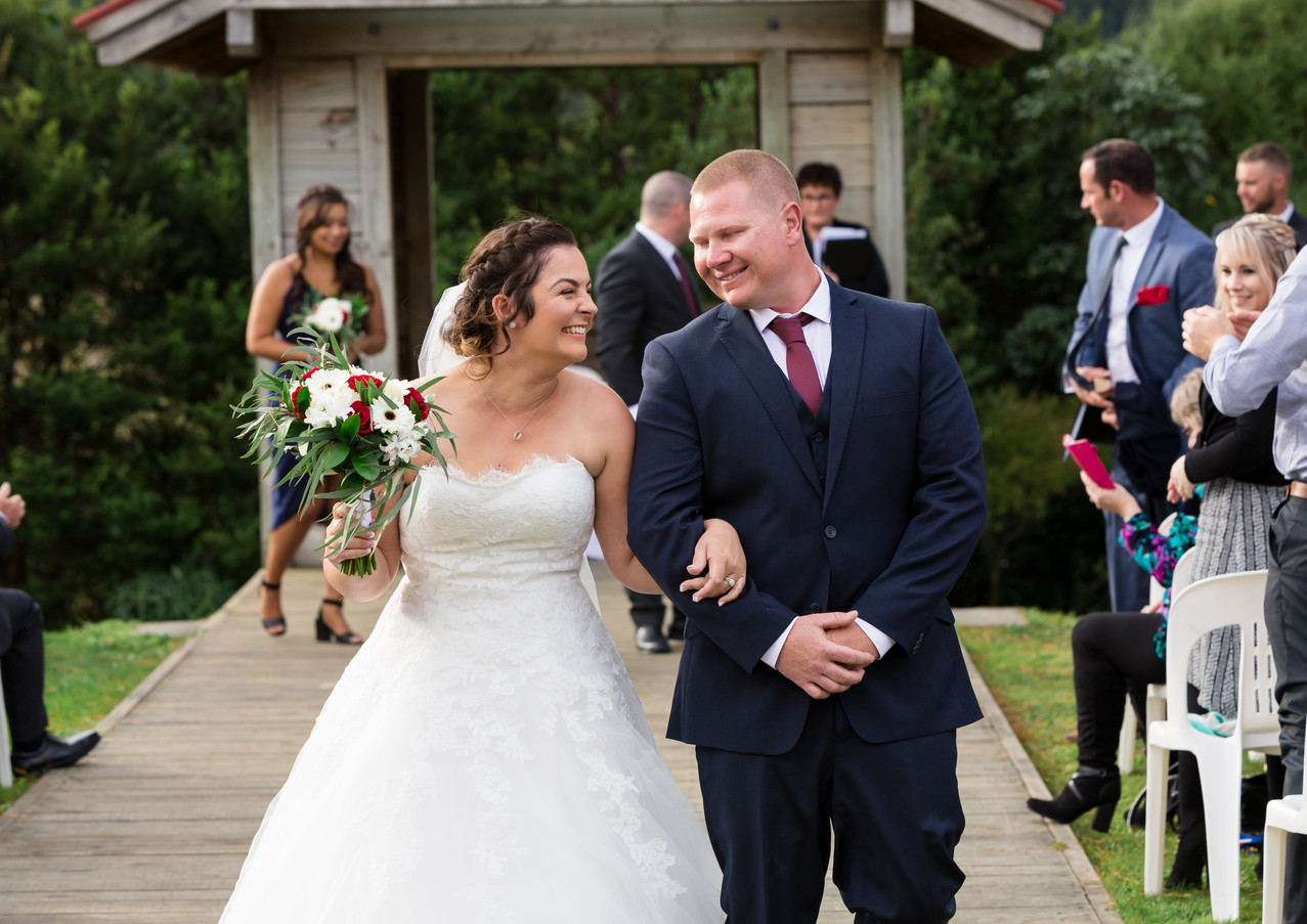 bride and groom wedding recessional at Silverstream Retreat in Wellington, New Zealand