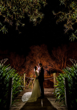 bride and groom night time wedding photo at Peppers Parehua in Wellington, New Zealand