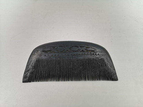 Hand carved ottoman comb