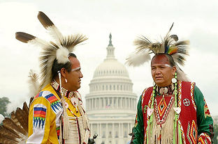 native americans in traditional dress, standing outside U.S. Capitol building in Washington DC