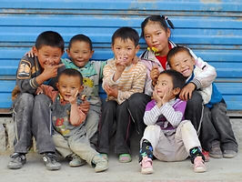 several children smiling and laughing