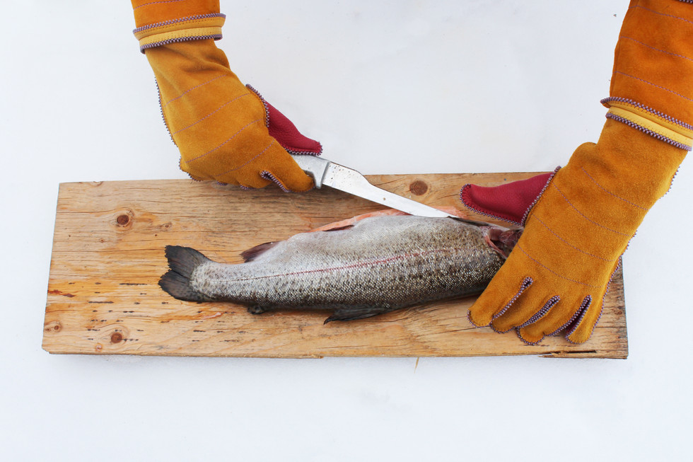 we carry our homeland(s) close to our heart (trout filleting detail), 2021.