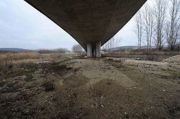 This photograph was taken by Pascal Ungerer and is part of the No Mans Land series of photographs. This art project explores some of the uncontested and uninhabited terrain on the margins of urban development. It is an inquiry into the aesthetic of a peripheral landscape of waste ground, unfinished building developments and forgotten places.