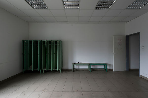 This photograph was taken by Pascal Ungerer and is part of The Empty Room series of photographs. This art project is about limenal, interstitial or in-between places, devoid of use. The empty spaces act as an allegory for various aspects of the human condition such as loss, choice, desolation, time and memory.