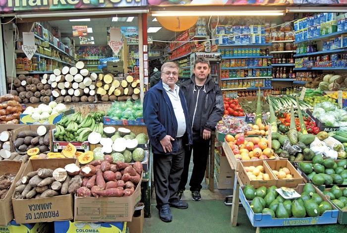 Simon-Omar-left-of-'Brixton-Foodland'-Brixton-Village-Market-Row