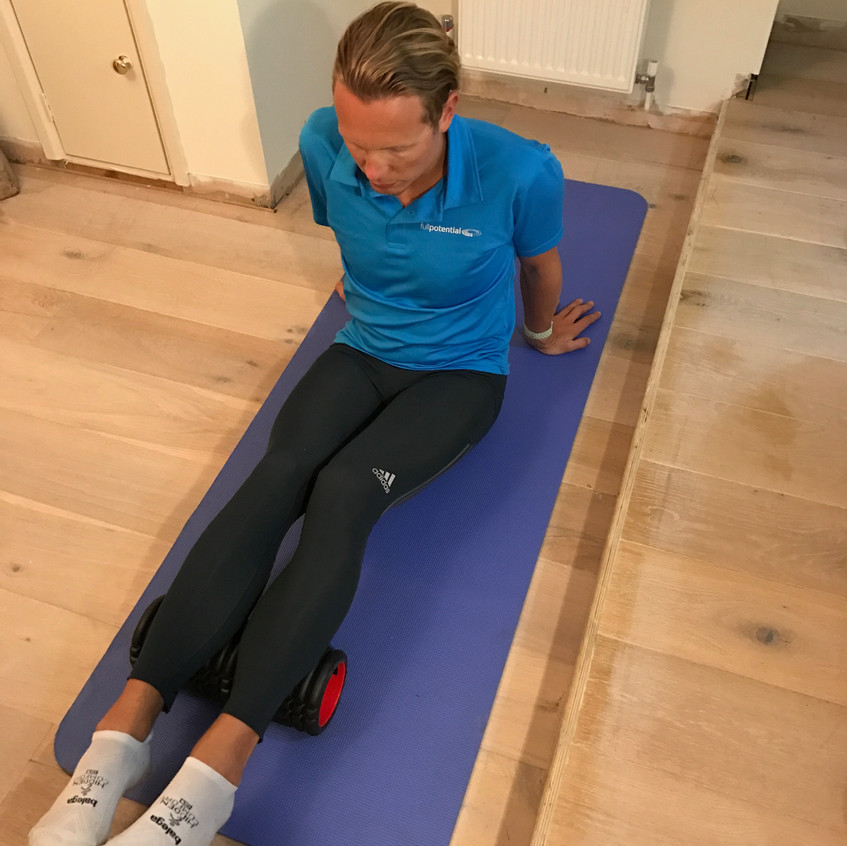 Putting two legs on the foam roller. Start here.