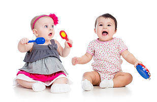 Funny babies girls  with musical toys. I