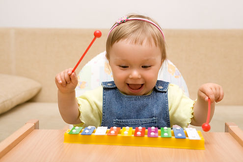 baby girl with instrument.jpg