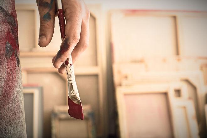 Holding a Paintbrush_edited.jpg