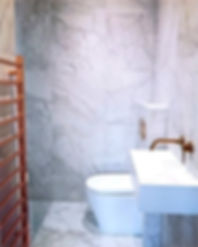 Ensuite with walk in shower and rose gold bathroom accessories