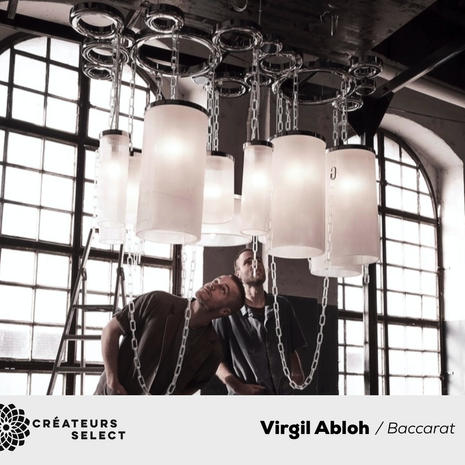 """""""CRYSTAL CLEAR"""" c/o Virgil Abloh™ """"CRYSTAL CLEAR"""" c/o Virgil Abloh™  - Previewed at Miami Art Basel 2019, the """"CRYSTAL CLEAR"""" collection by Virgil Abloh was unveiled in Paris at Maison Baccarat in the presence of the artist in February 2020. A piece of art, a mix of heritage and modernity, of elegance and industrial codes, realized at the manufacture of Baccarat by the artisans of Baccarat, the collection is made of a lighting unit, a center table unit and of glasses. All pieces in limited-edition are numbered and exclusively """"made to order"""" through the brand.  """"In any creative endeavor, I am interested in collaborating with the best in class. For me Baccarat represents the expression of the dynamism of crystal through history and today. The """"crystal clear"""" line of objects is an extension of my art practice, expertly realized by the artisans of Baccarat."""" —Virgil Abloh"""