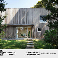 SheltonMindel Curtain Wall Too Michael Moran  - A modest single story L-shaped cottage on a bay side site in Sag Harbor was converted into a single two-story building. A key intent of the design was to create a sense of privacy from the street on the front of the house while on the back opening the interior to nature and open waterfront views.