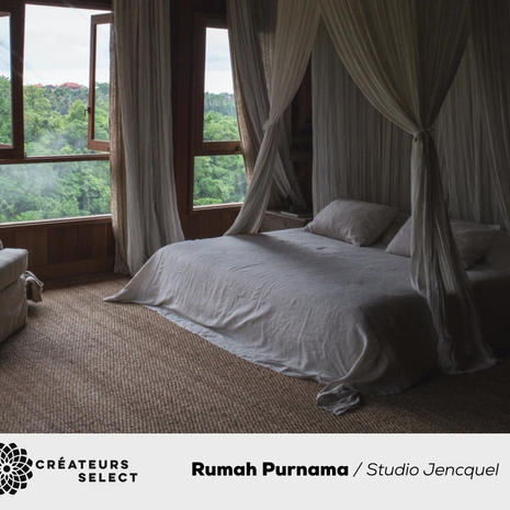 """Rumah Purnama  Studio Jencquel  - Rumah Purnama, which means """"The House of the Full Moon"""" in Bahasa Indonesia, is a heritage Balinese wantilan home that was recently fully restored and renovated by Studio Jencquel, to now encompass the luxuries of modernity while retaining the charm of Bali's bohemian heyday. In the shade of the centennial coconut trees and under a thatched roof, this charming 3-bedroom home boasts spectacular jungle and moonrise views across the sacred Campuhan Ridge, reminiscent of Walter Spies' influential paintings from 100 years earlier. The Campuhan village is known for its temple, Pura Gunung Lebah, located nearby where two mystical rivers unite. Spiritually significant to the Balinese Hindus as an energy center, this area has long been a source of inspiration for artists — and still holds the gentle enchantment of a bygone era."""