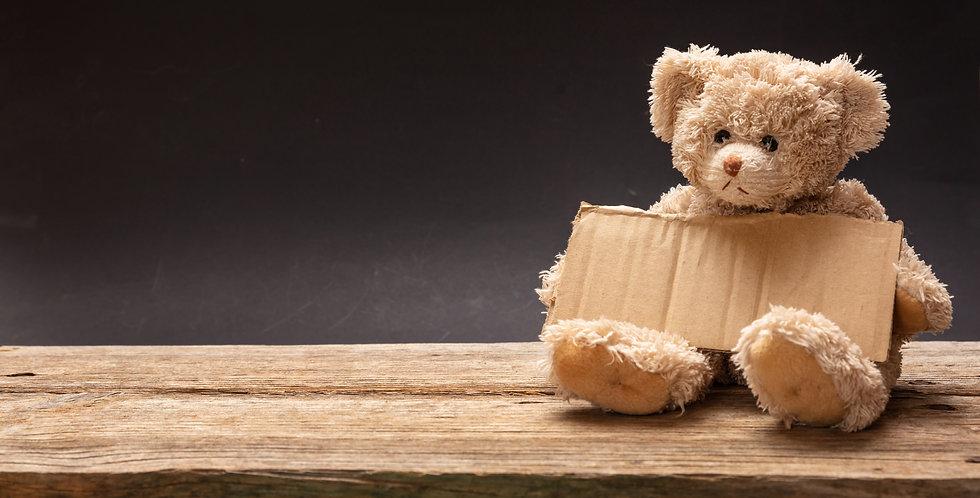 Poor homeless child begging. Teddy bear
