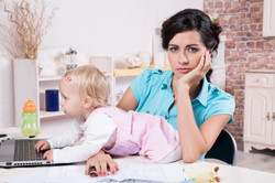 business woman with laptop and her baby girl.jpg