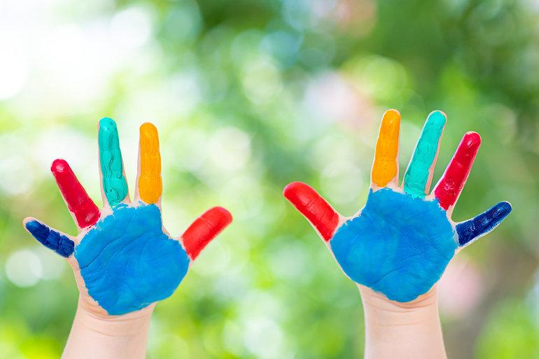 child-hands-painted-colorful-paints-read