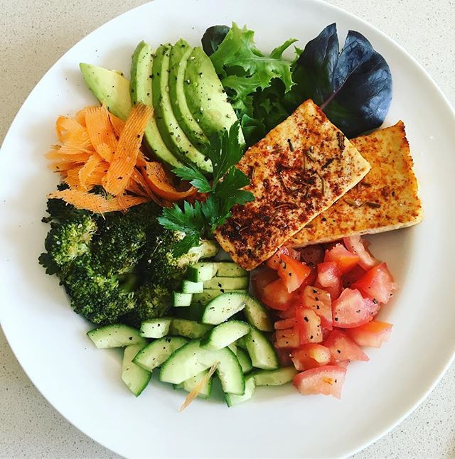 Vegan buddha bowl with rosemary paprika baked tofu
