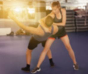 Young female  exercise captures with man
