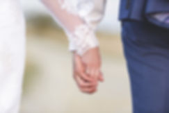 Pienza Bride and groom joining hands. Real wedding.