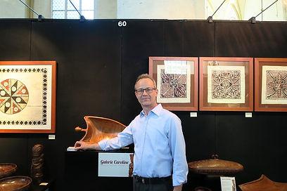 Antoine standing before stand Galerie Caroline at Exclusive Art Fair, Deventer, October 2015