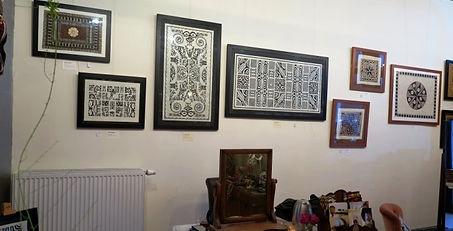 Galerie Caroline's decorated tapas on the wall in gallery Somewhere Els hosted by Els Van Steenacker, Antwerp