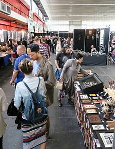 Visitors at stand of Galerie Caroline, Amsterdam Tattoo Convention, 29 May 2016