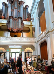 The stand of Galerie Caroline , nicely situated under the church organ... at The Amsterdam Traditional Jewelry and Textiles Fair, 25 september 2016