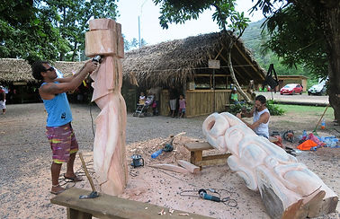 Two Rapanui artists creating typical Easter Island sculptures, artisans village, December 2015