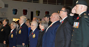 Photo credit: Colonel Alex Ruff (R) joined MPP Bill Walker, MP Larry Miller and Legion Veterans at the Chesley Remembrance                                                        Day Ceremony at the high school (Saugeen Times 2015)