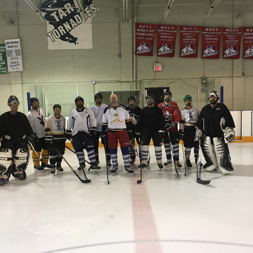 20 years of playing hockey with great friends, family and supporters.  Tara, ON. Alex Ruff (centre).