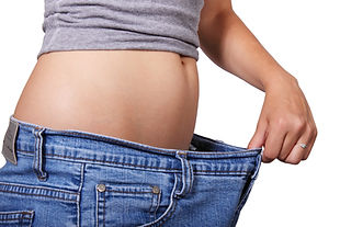 Female Stomach Holding Jeans At Robert Love, M.D. | Tummy Tuck In Little Rock, Arkansas