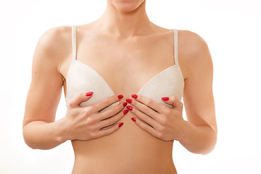Woman With White Bra Holding Breasts At Robert Love The III, M.D. | Plastic And Cosmetic Surgery In Little Rock, Arkansas