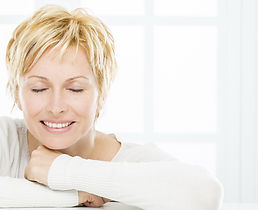 Smiling Middle Aged Woman At Robert Love III, M.D. | Eyelid Surgery In Arkansas