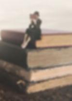 Sittingonbooks.jpg