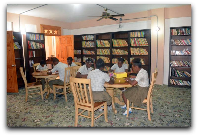 High School Students Enjoying the Library at Mission of Hope International