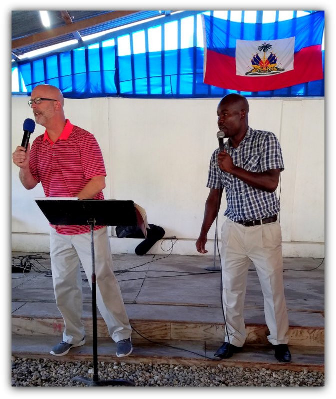 Gama translates for Pastor Mark Zimmerman