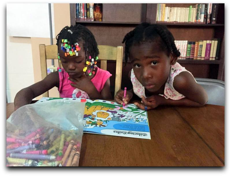 Coloring by numbers is a new activity for these girls