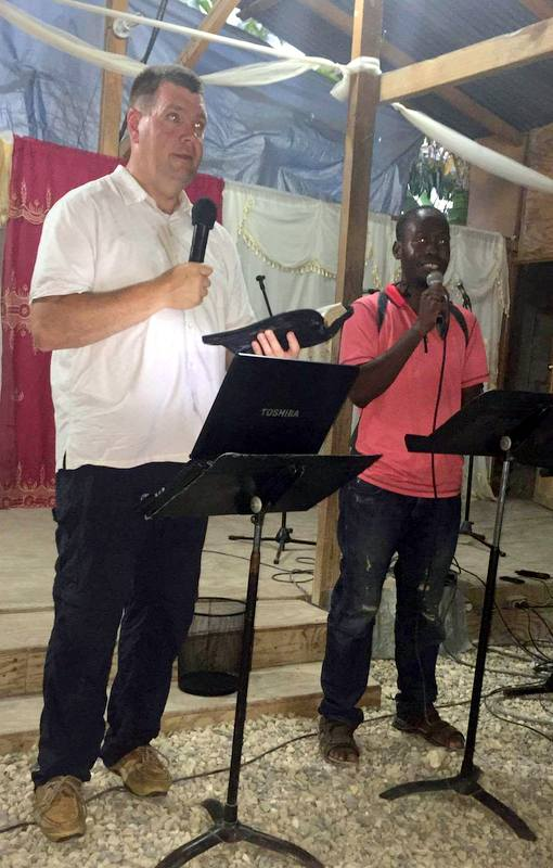 Pastor Bill Smith, the new executive director for Bless Back Worldwide, shares a message with the church in Thozin.